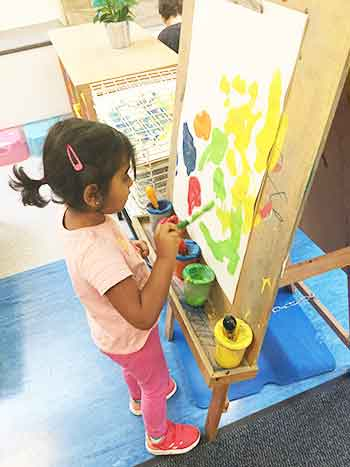 Girl painting at an easal